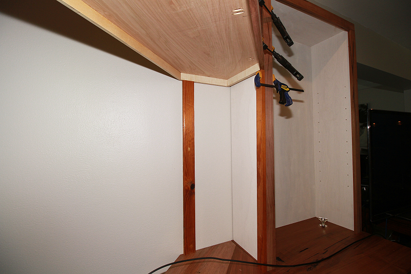 Securing An Angled Spanning Cabinet